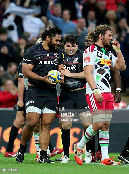 Billy Vunipola of Saracens is congratulated by teammate Scott Spurling after scoring his team's fifth and final try during the Aviva Premiership...