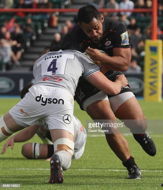 Billy Vunipola of Saracens is tackled by Charlie Ewels during the Aviva Premiership match between Saracens and Bath at Allianz Park on March 26 2017...