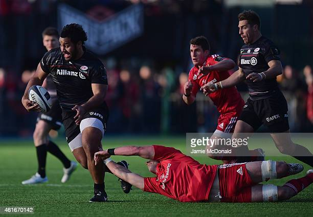Billy Vunipola of Saracens is tackled by Dave Foley of Munster during the European Rugby Champions Cup match between Saracens and Munster Rugby at...