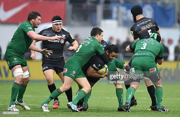 Billy Vunipola of Saracens is tackled by Fergus Mulchrone of London Irish during the Aviva Premiership match between Saracens and London Irish at...