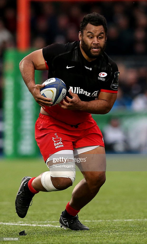 Billy Vunipola of Saracens runs with the ball duirng the European Rugby Champions Cup quarter final match between Saracens and Northampton Saints at...