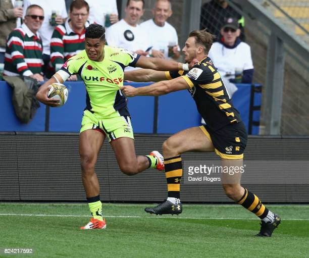 Billy Wara of Shale Sharks is tackled by Josh Bassett during the Singha Premiership Rugby 7s Series Day Two at Franklin's Gardens on July 29 2017 in...