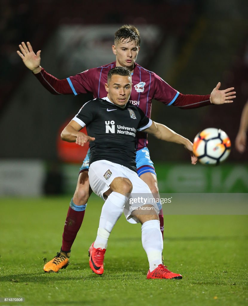 Billy Waters of Northampton Town looks to control the ball under pressure from Conor Townsend of Scunthorpe United during the Emirates FA Cup First Round Replay match between Scunthorpe United and Northampton Town at Glanford Park on November 14, 2017 in Scunthorpe, England.