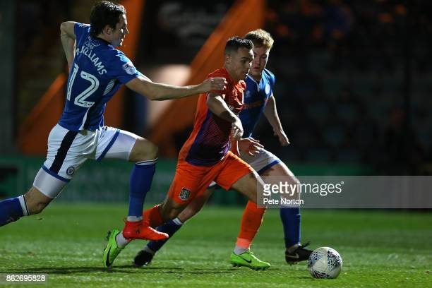 Billy Waters of Northampton Town moves with the ball between Mj Williams and Callum Camps of Rochdale during the Sky Bet League One match between...