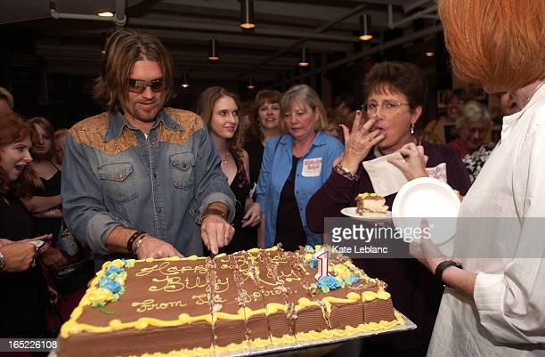 BillyRay_KL04_081505_ Billy Ray Cyrus cuts his birthday cake at a party thrown for him by his fan club the Spirit who cluster around him They came in...