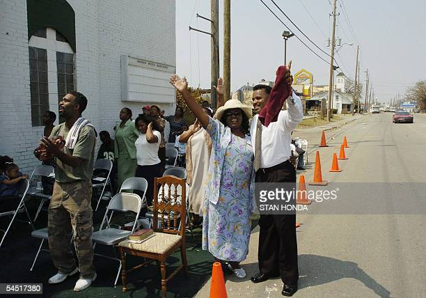 Bishop Debruce Nelson and his wife Janet embrace outside the Lighthouse Apostolic Holiness Church during an outdoor Sunday service 04 September 2005...