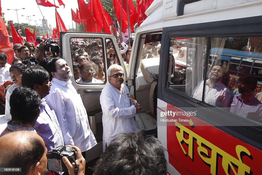Biman Bose West Bengal state chief of CPI (M) leading Eastern Sangharsh Sandesh Jatha flagged of by former Chief Minister of West Bengal Buddhadeb Bhattacharya at Rani Rashmoni Road on March 1, 2013 in Kolkata, India. Starting from West Bengal this Jatha will travel through the states of Jharkhand, Bihar, Uttar Pradesh, Haryana and culminate in Delhi on March 14, 2013. The Jatha will apprise the masses about the alleged anti-people policies of the UPA regime.