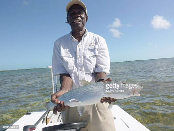 Bimini bonefish guide 'Eagle Eyes' Fred Rolle holds up a bonefish caught and released by Sue Cocking on fly rod recently