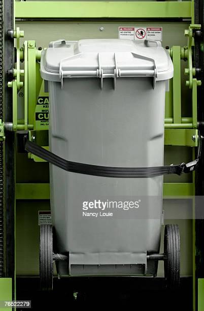 Bin lift on a recycling truck.
