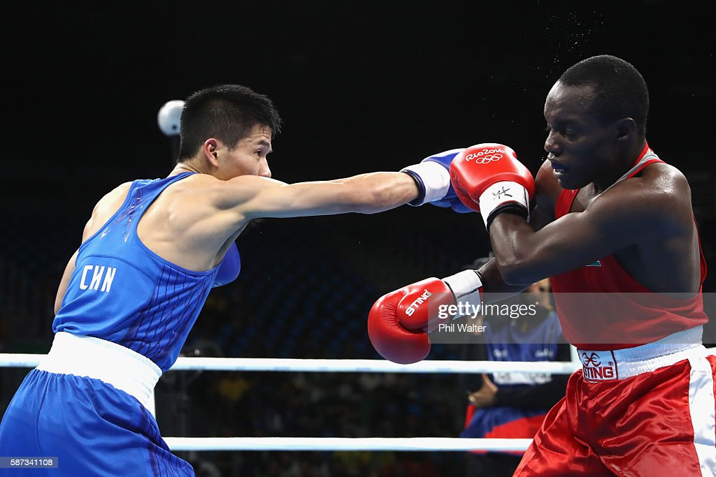 Bin LV of China fights Peter Mungai Warui of Kenya in their Mens 4649 Light Fly Weight bout on Day 3 of the Rio 2016 Olympic Games at the Riocentro...