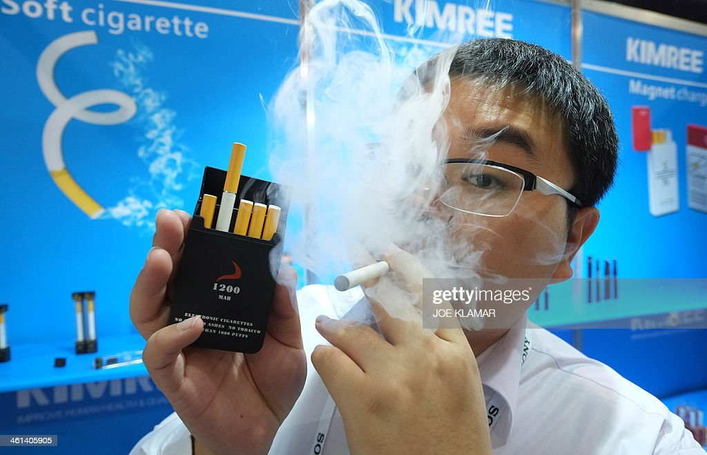Bin Zhou of Kimree shows electronic cigarettes at the Kimree booth during the 2014 International CES at the Las Vegas Convention Center on January 8, 2014 in Las Vegas, Nevada. CES, the world's largest annual consumer technology trade show, runs through January 10 and is expected to feature 3,200 exhibitors showing off their latest products and services to about 150,000 attendees. AFP PHOTO/JOE KLAMAR