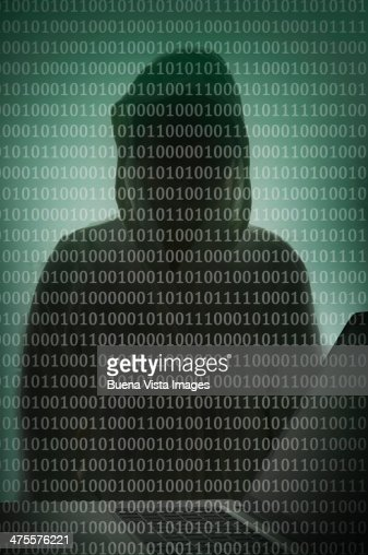 Binary code and hacker over a laptop