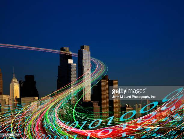 Binary code flowing in cityscape at night
