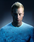 Binary code projected onto man's face and chest