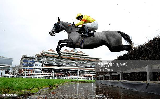 Bincome ridden by Conor Smith takes the water jump during the The bet365 Conditional Jockeys Handicap Steeple Chase at Newbury Racecourse on November...