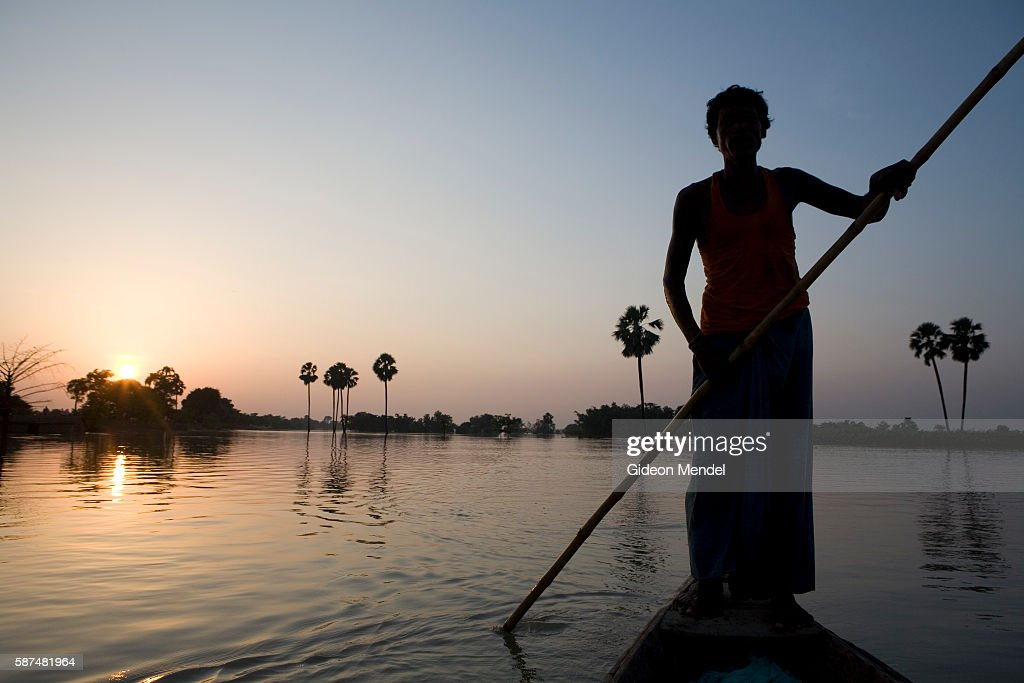 Bindeshwar Sahni punts a boat over flooded farmland near Pirmuhammadpur village on the banks of the river Ganda which was totally submerged by the...