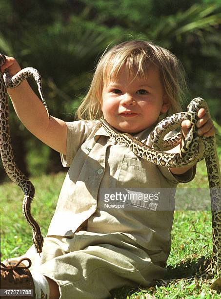 Bindi Irwin daughter of Steve Irwin with with Burmese Pythons