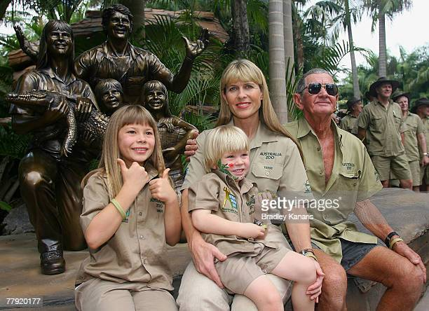 Bindi Robert Terri and Bob Irwin pose in front of a statue of the family that was unveiled today during 'Steve Irwin Memorial Day' at Australia Zoo...