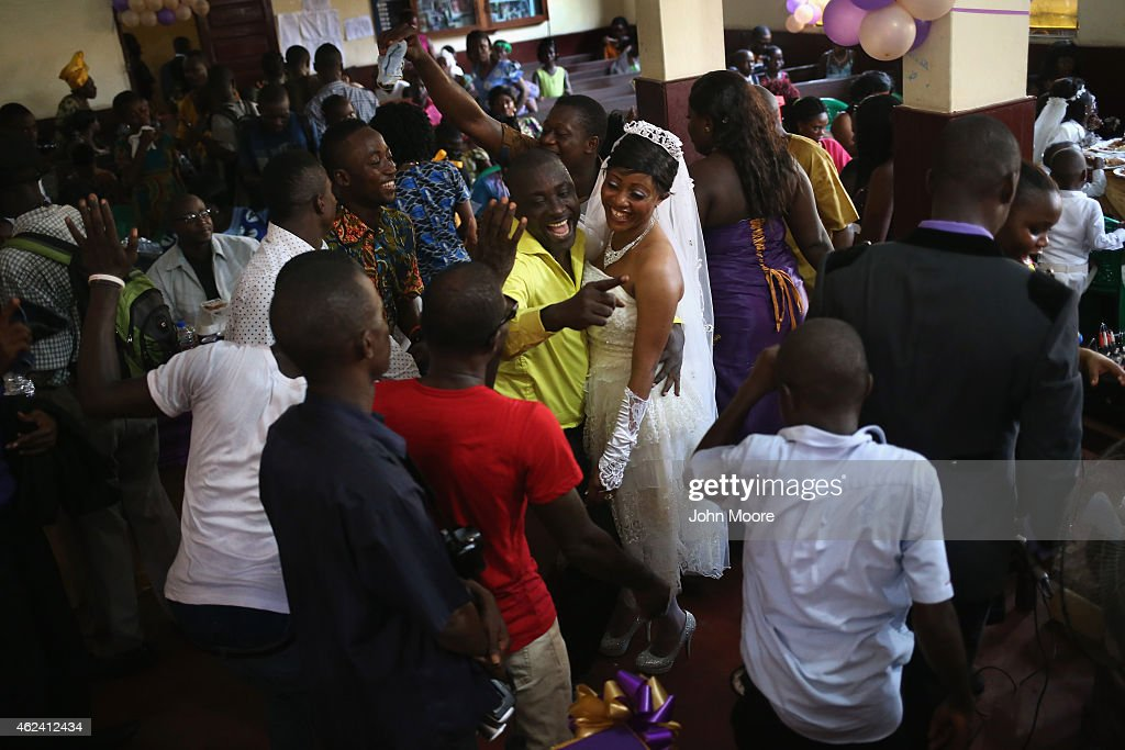 Bindu Quaye celebrates with friends at her wedding reception on January 24 2015 in Monrovia Liberia Like many couples Quaye and her groom Clarence...
