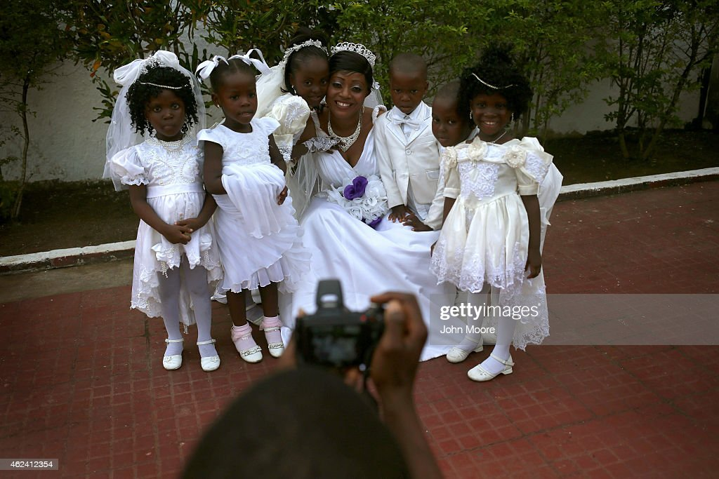 Bindu Quaye poses for photos with flower girls before her wedding reception on January 24 2015 in Monrovia Liberia Like many couples Quaye and her...