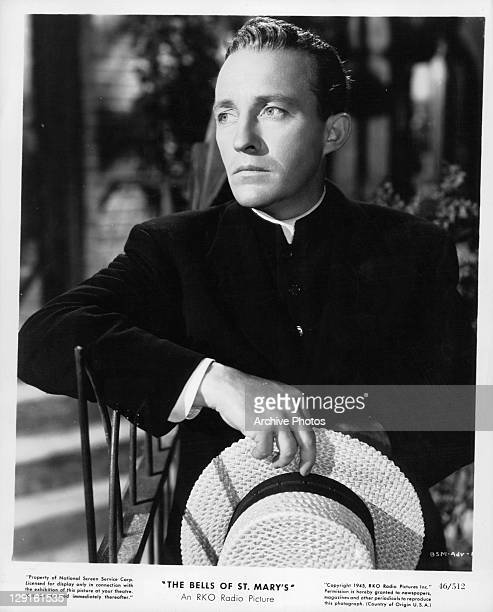 Bing Crosby holding straw hat in a scene from the film 'The Bells Of St Mary's' 1945