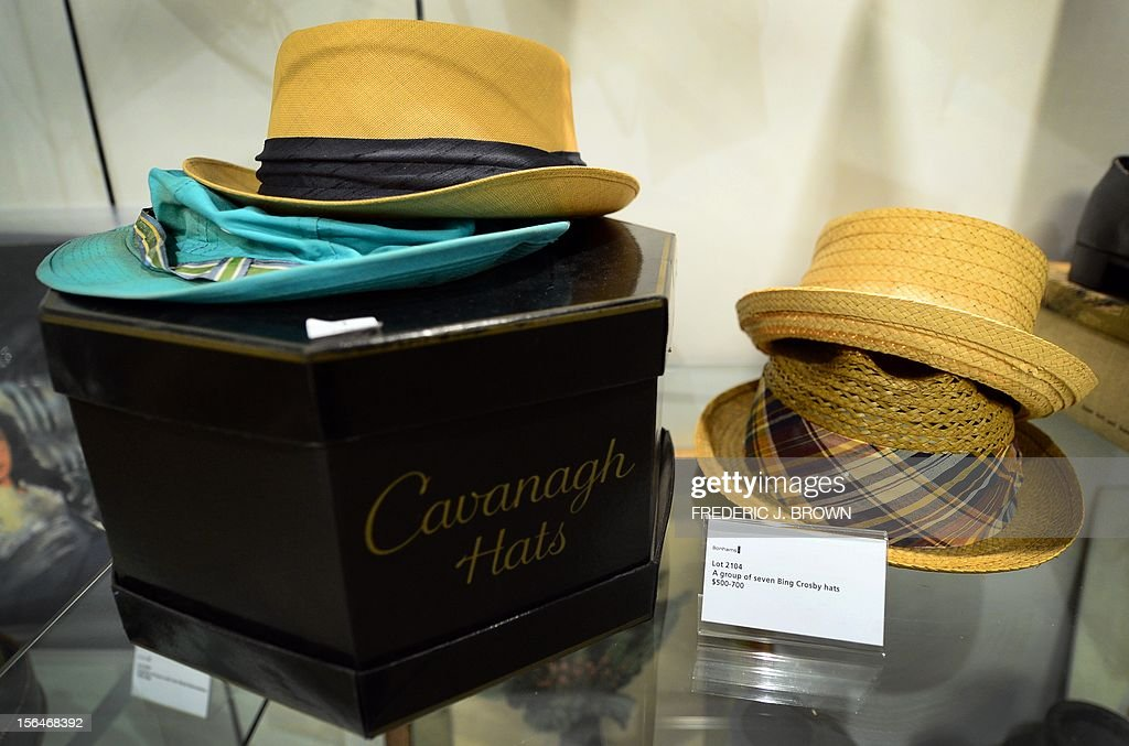 Bing Crosby's hats, a set of seven esitmated between $500 and $700, on display during a press preview at auction house Bonham's in Hollywood, California, on November 15, 2012, where Charlie Chaplin's iconic bowler hat and cane are to go under the hammer in this weekend as part of an auction which also includes the John Lennon nude drawing of himself and Yoko Ono, part of the Lennon lot estomated between $18,000 and $22,000 , among memorabilia from other artists. The hat and cane trademark of Chaplin's Little Tramp character are in 'remarkable condition' and are estimated to go for between $40,000 and $60,000 at the sale by auction house Bonhams on Sunday November 18. AFP PHOTO / Frederic J. BROWN