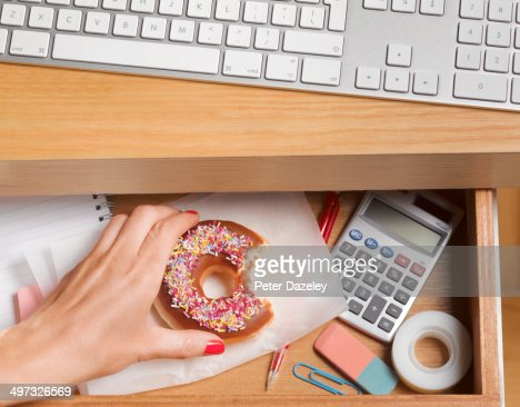 Binge eater hiding doughnut in desk drawer