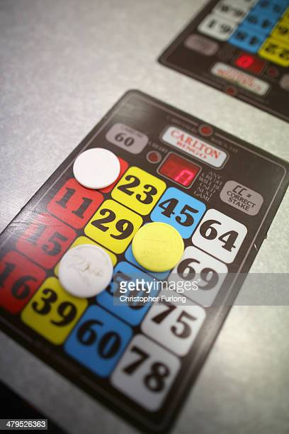 Bingo boards sit on a table as people play Bingo at Carlton Bingo Hall in Orrell Park as the Chancellor George Osborne announces tax breaks for Bingo...