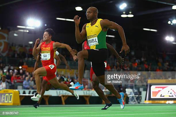 Bingtian Su of China and Asafa Powell of Jamaica compete in the Men's 60 Metres SemiFinal during day two of the IAAF World Indoor Championships at...