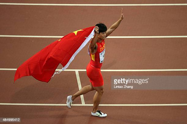Bingtian Su of China applauds the fans after crossing the finish line in the Men's 100 metres final during day two of the 15th IAAF World Athletics...