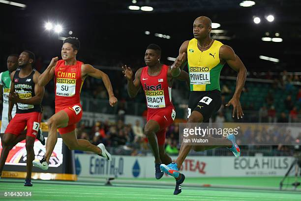 Bingtian Su of China Marvin Bracy of the United States and Asafa Powell of Jamaica compete in the Men's 60 Metres SemiFinal during day two of the...