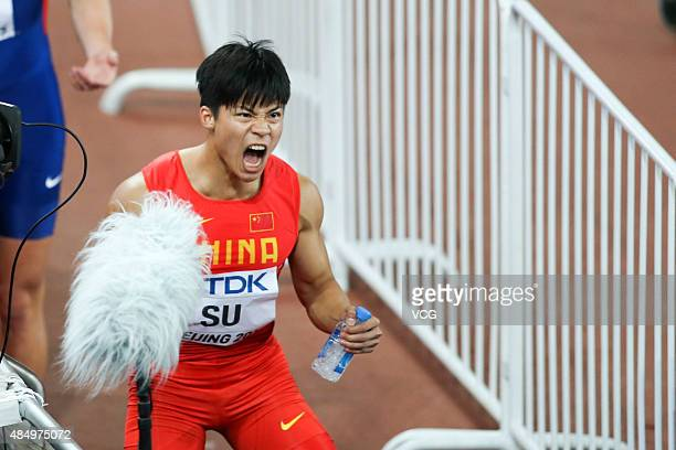 Bingtian Su of China reacts after crossing the finish line in the Men's 100 metres semifinal during day two of the 15th IAAF World Athletics...