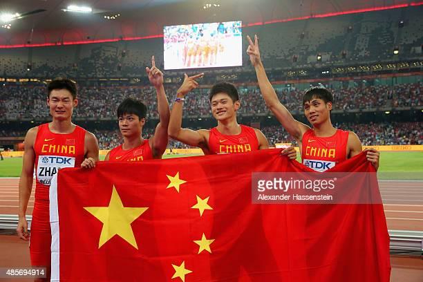 Bingtian Su of China Zhenye Xie of China Peimeng Zhang of China and Youxue Mo of China celebrate after winning silver in the Men's 4x100 Metres Relay...