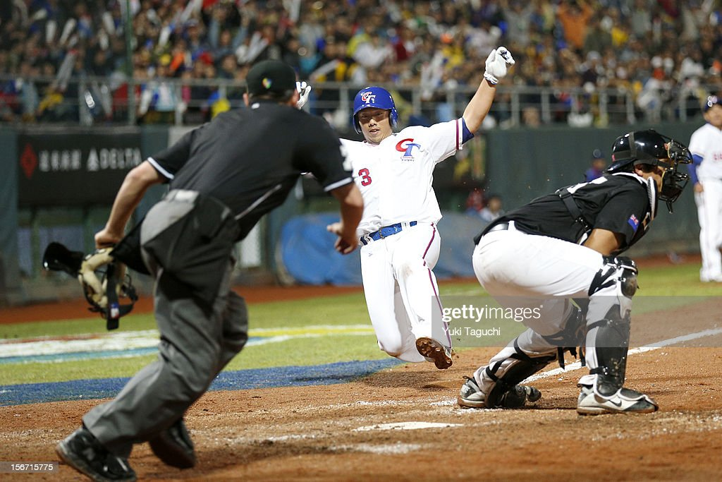 Bing-Yen Lee #3 of Team Chinese Taipei slides safely into home in the bottom of the seventh inning during Game 6 of the 2013 World Baseball Classic Qualifier against Team New Zealand at Xinzhuang Stadium in New Taipei City, Taiwan on Sunday, November 18, 2012.