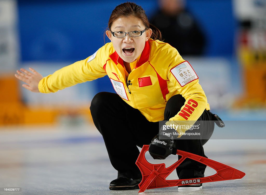 Bingyu Wang of China screams instructions to team mates in the match between Germany and China on Day 4 of the Titlis Glacier Mountain World Women's Curling Championship at the Volvo Sports Centre on March 19, 2013 in Riga, Latvia.