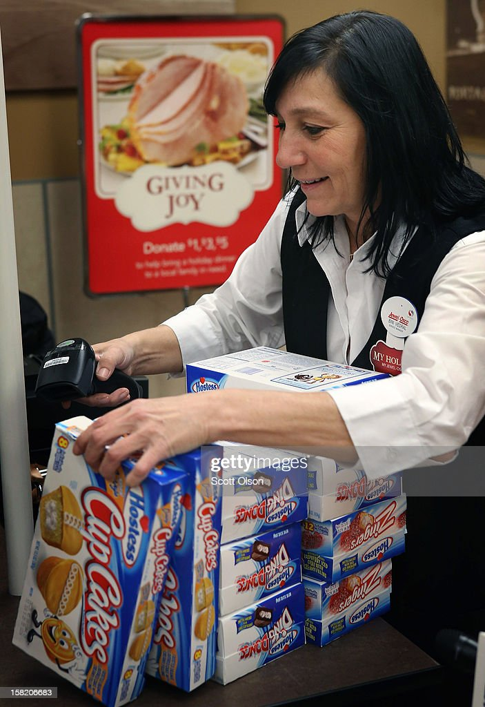 Bini Vedral rings up a customers purchase of Hostess snacks at a Jewel-Osco grocery store on December 11, 2012 in Chicago, Illinois. The Jewel-Osco grocery store chain purchased the last shipment of 20,000 boxes of Hostess products and put them on sale in their stores throughout the Chicago area today. Hostess Brands Inc. shut down its baking operations and began liquidating assets last month after failing to negotiate a labor contract with Workers with the Bakery, Confectionery, Tobacco Workers and Grain Millers International Union