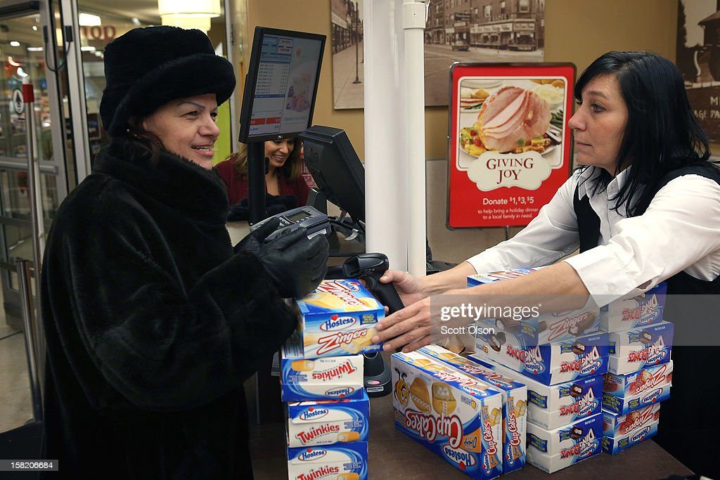 Bini Vedral (R) rings up a Lila Prskalo's purchase of Hostess snacks at a Jewel-Osco grocery store on December 11, 2012 in Chicago, Illinois. The Jewel-Osco grocery store chain purchased the last shipment of 20,000 boxes of Hostess products and put them on sale in their stores throughout the Chicago area today. Hostess Brands Inc. shut down its baking operations and began liquidating assets last month after failing to negotiate a labor contract with Workers with the Bakery, Confectionery, Tobacco Workers and Grain Millers International Union