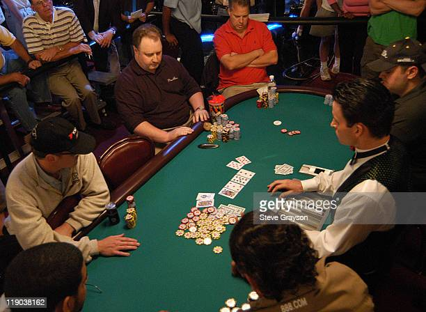 Binions Horseshoe Club and Casino dealers deal cards to constestants during day six of the 2004 World Series of Poker at Binion's Horseshoe Club and...