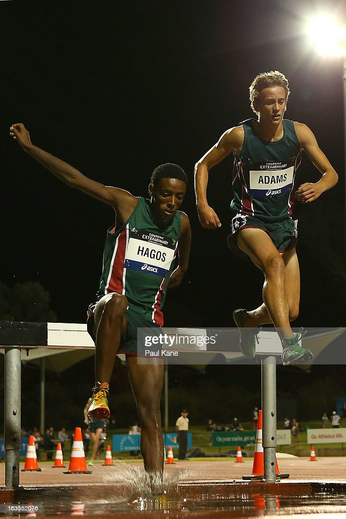 Biniyam Hagos and Kale Adams of Tasmania compete in the Men's under 18 2000 metre steeplechase during day one of the Australian Junior Championships at the WA Athletics Stadium on March 12, 2013 in Perth, Australia.