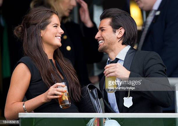Binky Felstead and Ollie Locke watch the racing as they attend the QIPCO British Champions Day meet at Ascot Racecourse on October 20 2012 in Ascot...