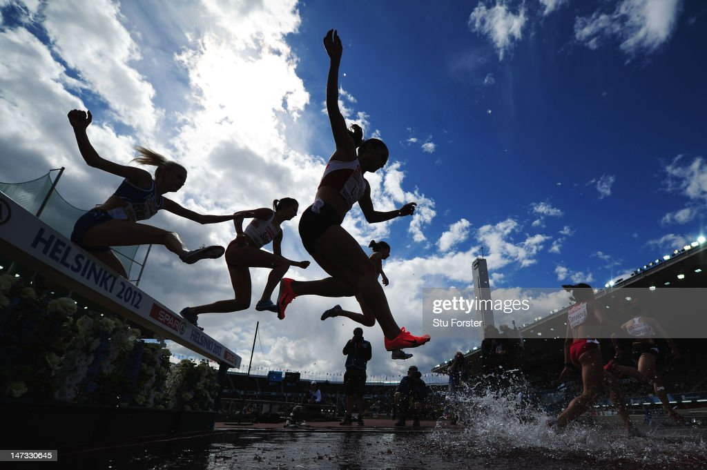 Binnaz Uslu of Turkey and Sandra Eriksson of Finland compete in the Women's 3000 metres Steeplechase Semi Finals during day two of the 21st European Athletics Championships at the Olympic Stadium on June 28, 2012 in Helsinki, Finland