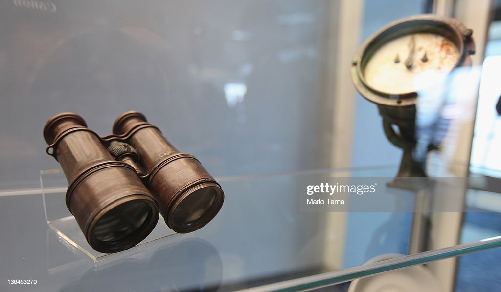 Binoculars (L) and a logometer, used to measure boat speed, are seen among artifacts recovered from the RMS Titanic wreck site at a press preview of a Titanic artifact auction at the Intrepid Sea, Air & Space Museum on January 5, 2012 in New York City. On April 11, 2012, the 100th anniversary of the maiden voyage of the Titanic, Guernsey's will auction the complete collection of more than 5,000 artifacts recovered from the Titanic wreck site.