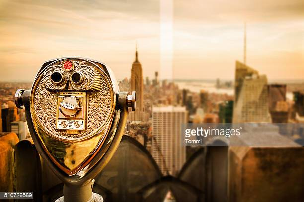 Binoculars Overlooking New York City Skyline At Empire State Building