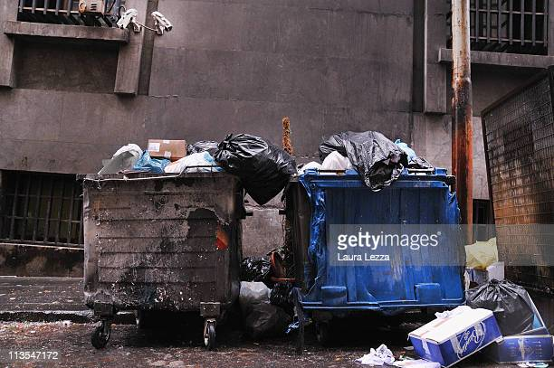 Bins burned by an exasperated population near a pile of uncollected rubbish off Via Roma on May 2 2011 in Naples Italy Italy's third largest city is...