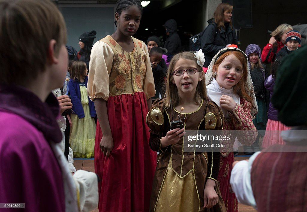 Bintou Diane, 11, left, Payden Coffey, 8, and Chloe McPhee, 10, right, perform The Comedy of Errors with fellow classmates from Lowry Elementary School. Despite rain and snow, over 5,000 Denver Public School students participate in the 32nd annual Denver Public School Shakespeare Festival at the Denver Center for the Performing Arts Complex.The day-long festival hosts a forum for students from Kindergarten through 12th grade to perform sonnets and scenes from the works of Shakespeare, as well as dance, vocal, and instrumental music of Shakespeare's time.