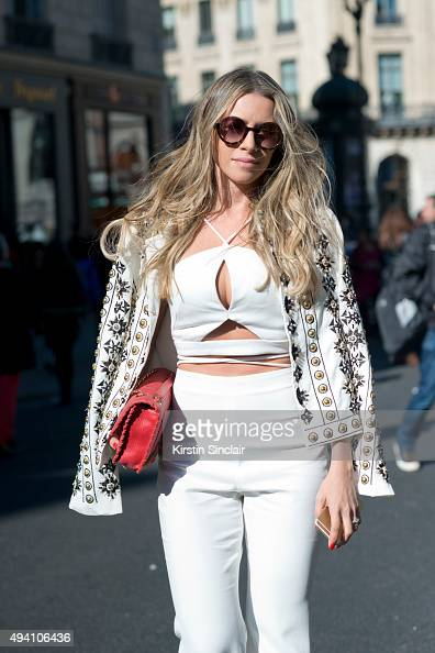 Biochemist Isabella Diniz wears Marc Jacobs sunglasses an Emporium jacket top and trousers and a Chanel bag on day 3 during Paris Fashion Week...