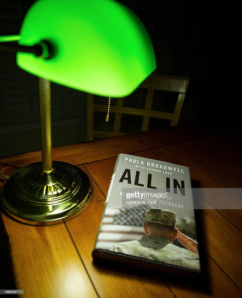 "Biographer Paula Broadwell's book 'All In: The Education of General David Petraeus,' is seen on a desk in Manassas, Virginia, on November 13, 2012. Petraeus' surprise resignation as CIA director resulting from an extramarital affair has now spiraled into a complicated story of infidelity, intrigue and politics. Petraeus' admission of an extramarital affair quickly led to his biographer, Paula Broadwell, and an examination of her relationship with the decorated war hero. The length of the FBI's investigation of ""menacing"" emails sent to Petraeus' family friend Jill Kelley, and the timing of the announcement of his departure from the Obama administration fueled conspiracy theories. Then Gen. John Allen, Petraeus' successor as military commander in Afghanistan, was embroiled in the scandal, accused by US officials of sending ""inappropriate"" emails to Kelley. AFP PHOTO/Karen BLEIER"