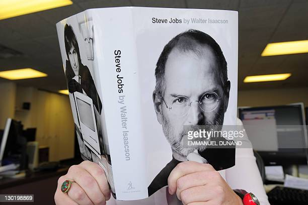 A biography of Apple cofounder Steve Jobs is pictured held by a reader in New York October 24 2011 The eagerly awaited biography of Apple cofounder...