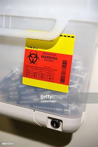 Biohazard label on sharps container