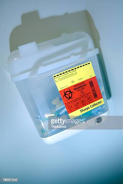 Biohazard waste container with spent needles